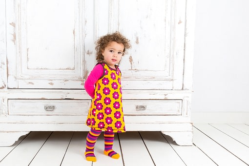 Organic cotton pinafore with stripy tights