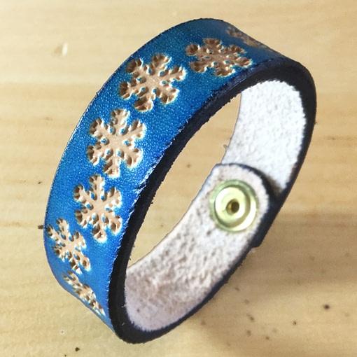 Snowflakes on handmade blue leather bangle 1