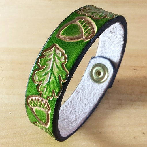 Acorns and oak leaves on handmade green leather bangle 1