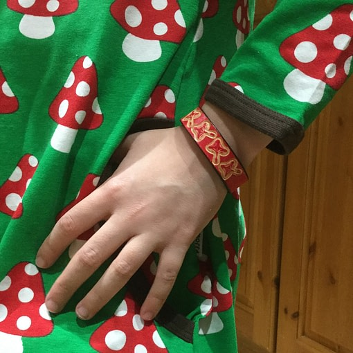 Toadstools on handmade red leather bangle 2