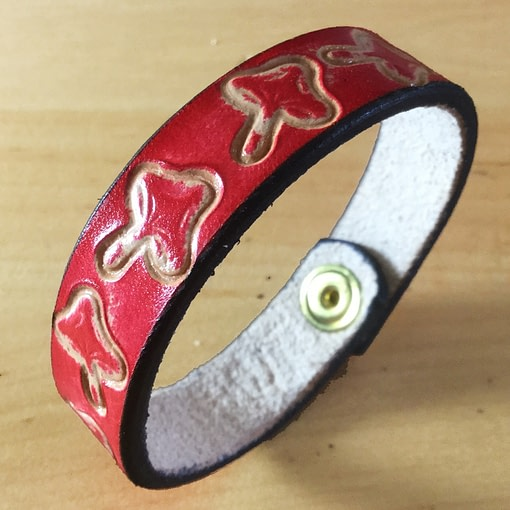 Toadstools on handmade red leather bangle 1
